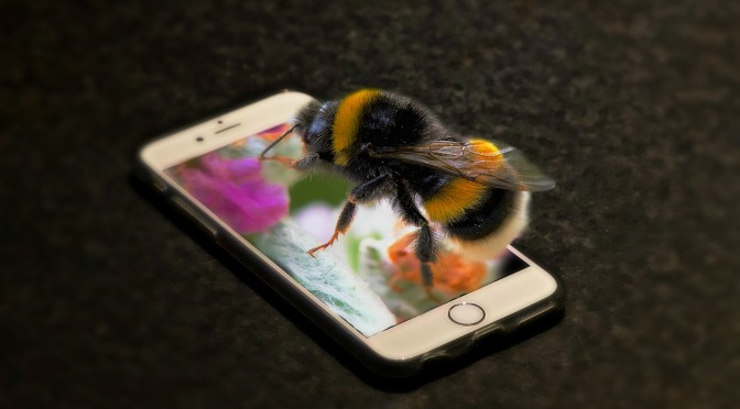 A bee on top of a mobile phone, illustration